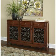 powell scroll console table powell furniture 3 door scroll console in walnut 246 335