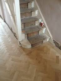 a herringbone design parquet floor here shown with a