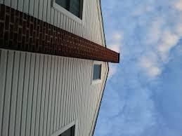 wet wood in attic shingles window installed chimney house