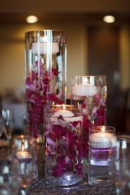 candle centerpieces purple orchid and floating candle centerpieces
