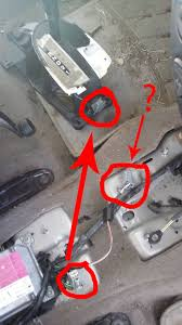 electrical mystery wiring harness underneath the gearshift on a