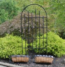 wrought iron trellis and flower baskets ebth