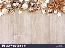 top border with white and gold ornaments on a rustic wood