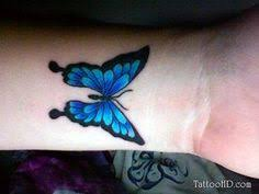 tiny blue butterfly on wrist tattooshunt com inked