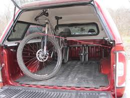 Rack For Nissan Frontier by Bikes In Truck Bed With Topper Mtbr Com
