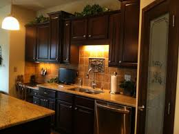 Lighting Above Kitchen Cabinets No Window Over Your Sink Use A Decorative Piece That Coordinates