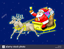 santa claus sitting in his sleigh flying with reindeer stock photo