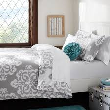 simple bedroom with gray white bedding decor gray floral print