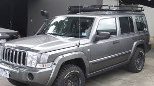 jeep commander with oval steel roof rack installed on tradesman