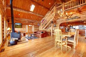large luxury log house living room with staircase stock photo