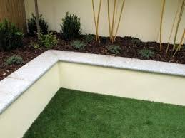 innovative garden wall capping painted rendered block raised bed