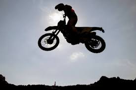 motocross freestyle action photos motocross racers tear through the sky from the