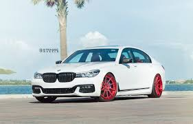 teal car white rims alpine white bmw 740i with red strasse wheels