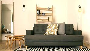 over the couch lighting floor l behind sofa and arc sectional pottery barn with couch c