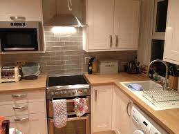 gloss kitchen tile ideas howdens burford gloss with grey craquele tiles kitchens