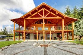 cabin porch large log cabin with large porch and fire circle stock photo