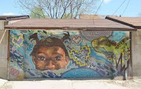 moon as i walk toronto street art mural on a wall in an alley a girls face two little