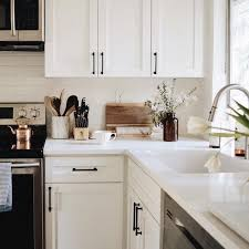 kitchens white cabinets white cabinets with black hardware the everygirl decorates