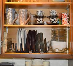organizer for kitchen cabinets with tools in the cupboard