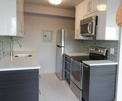kitchen cabinets white marble countertops and dark cabinets small