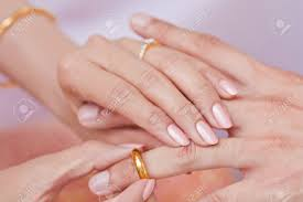 ring marriage finger wear golden ring in to finger stock photo