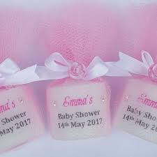 unique personalised baby shower candle favours wrapped in tulle