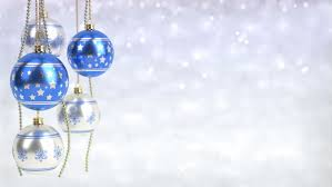 gold and blue colored ornaments are hanging against blue