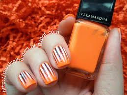 halloween nail art neon orange purple and white stripes of