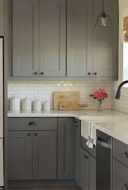 grey kitchen cabinets with white countertops outofhome