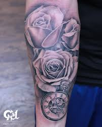 black and gray rose tattoo by capone tattoonow