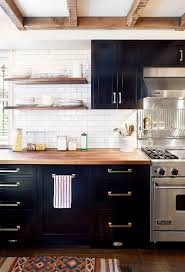 9 ways to make your kitchen look more expensive kitchen Black Kitchen Cabinets