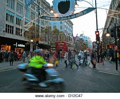 blurred people christmas shopping at oxford circus london in