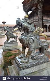 metal lion statue metal lion statues guard a temple from evil spirits durbar square