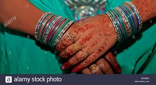 human hand asian ethnicity henna tattoo indian women bangles