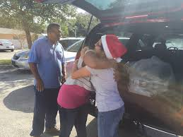 salvation army of broward county donors and volunteers distribute