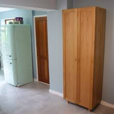 Free Standing Kitchen Pantry Furniture Unfinished Oak Wood Free Standing Kitchen Pantry With 2 Doors Free