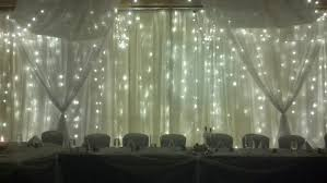 warm white led twinkle lights light wall with sheer swags warm white led twinkle lights fabric