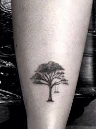 small oak tree tatto on back leg
