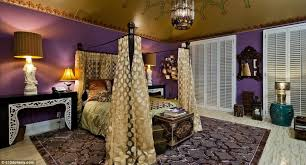 purple gold bedroom with unique table lamps and curtains also