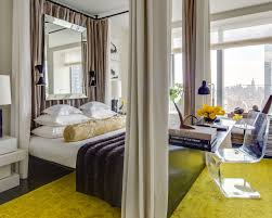fancy blue bedroom focused on high loft bed over desk and storage
