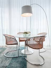 dining room with round dining table and modern chairs and using