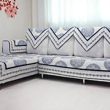 sofas design style with grey fabric cushioning and polka dot throw