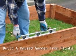 How To Install A Raised Garden Bed - how to build a raised garden from planks homestead u0026 survival