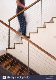 Walking Up Stairs With Crutches by Man Walking Up Apartment Stairs Stock Photos U0026 Man Walking Up