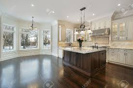 kitchen in new construction home with eating area stock photo kitchen in new construction home with eating area stock photo 6739820