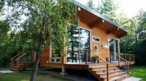 modern elegant design of the modern log cabin kits that can be