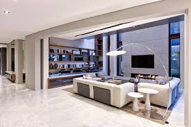 living room living room marble white marble floors brown wood paneling on the walls and