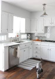 white kitchen white appliances cherry wood saddle shaker door small kitchen white cabinets