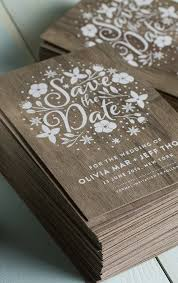 stunning wedding invites produced on real wood with white printing