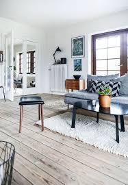 wall art gray sofa monstera plant scandinavian interior mid